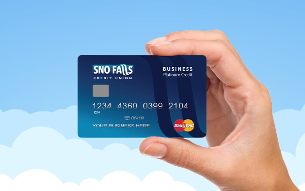 Hand holding a Sno Falls business credit card