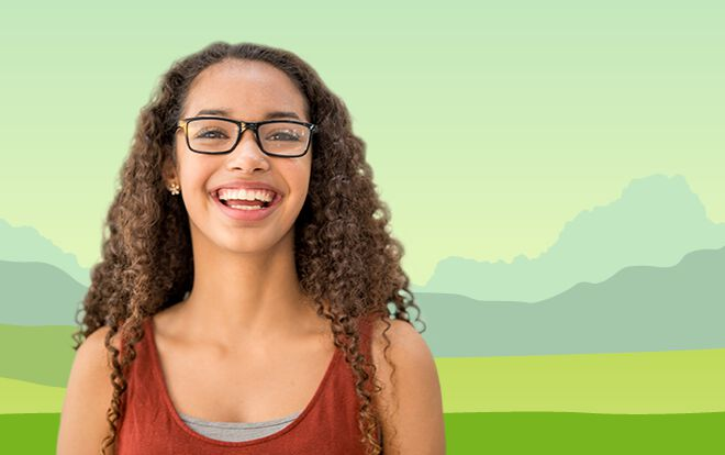 Young woman smiling in front of illustrated field