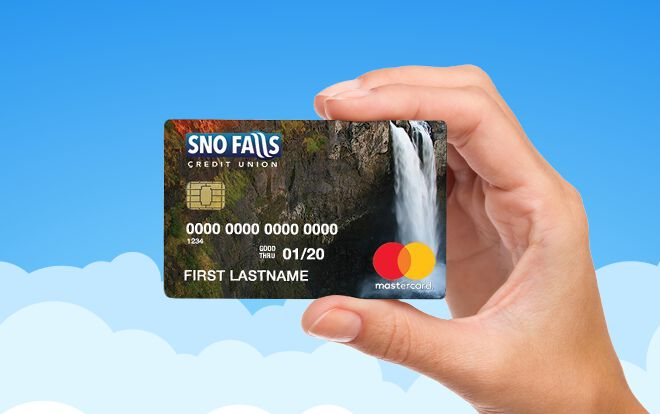 Hand holding a Sno Falls debit card in front of illustrated clouds