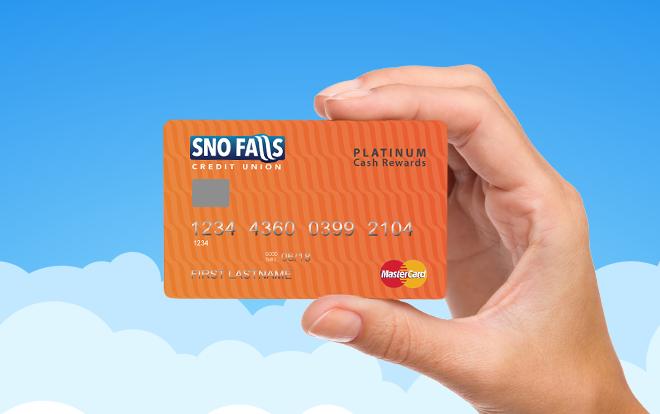 Hand holding Sno Falls Platinum Cash Rewards credit card.