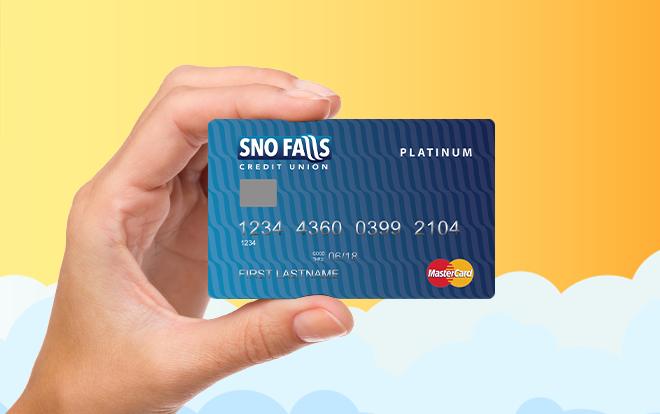 Hand holding Sno Falls Mastercard Platinum credit card.