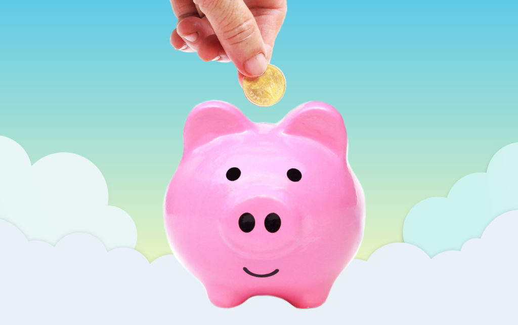 Coin being deposited into piggy bank with cloud background